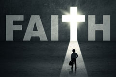 Kid standing in faith door Stock Image