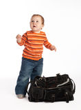 Kid standing beside female bag Stock Image