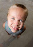 Kid standing lookup up Stock Image