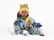 Kid standing in snow. A cute little kid standing in the white snow Stock Image