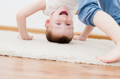 Kid standing upside down Royalty Free Stock Images