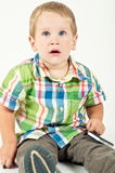 Kid staring at the camera. In studio isolated on white background Royalty Free Stock Image