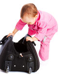 Kid stepping into bag Stock Images