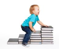 A kid on a steps of books Stock Photography