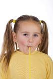 Kid and a straw. Kid sucking a straw isolated on white Stock Image