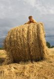 Kid on Straw Bale Stock Image