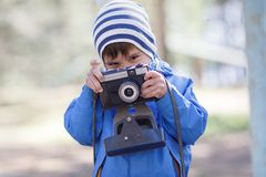 Child,Baby boy with camera stock images