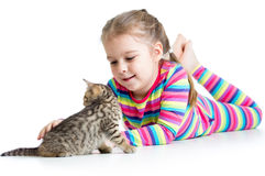 Kid stroking cat kitten Royalty Free Stock Image