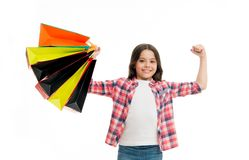 Kid strong makes independent purchases. Girl carries shopping bags isolated on white background. Girl fond of shopping royalty free stock photos