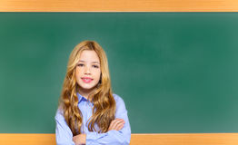 Kid student girl on green school blackboard Royalty Free Stock Photo