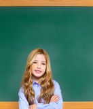 Kid student girl on green school blackboard Royalty Free Stock Images