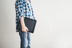 Kid student with  tablet Stock Photos