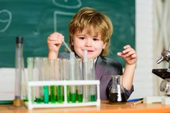 Kid study chemistry. Biotechnology and pharmacy. Genius pupil. Chemical analysis. Science concept. Wunderkind royalty free stock photos