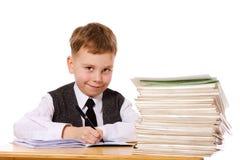 Kid studying. Smiling kid studying isolated on white Stock Images