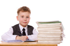 Kid studying. Smiling kid studying writing isolated Royalty Free Stock Images