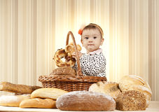 Kid studying bread Royalty Free Stock Photography