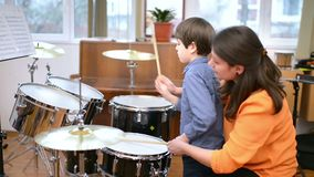 Kid studying drums stock video footage