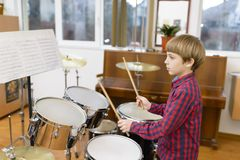 Kid Studying Drums Royalty Free Stock Images