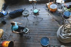 Kid studying drums at school. Training pad stock images