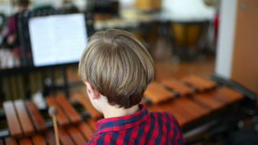 Kid Studying Percussion Instrument stock footage
