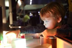 Kid studying the refraction of light. In lab stock images