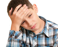 Kid sturving from headache Stock Photography