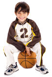 Kid stylishly sitting on the ball Stock Photos