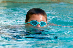 Kid submerging in the pool. Stock Image