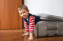 Kid in suitcase Stock Photo
