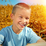 Kid in the Summer Field Stock Photos