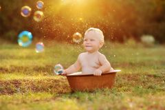 Kid and sun Stock Images