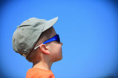 Kid with sunglasses and cap outdoor Stock Photo