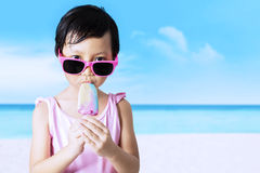 Kid with sunglasses enjoy ice cream Stock Images