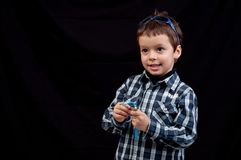 Kid with sunglasses on head keeping track of time Royalty Free Stock Photos