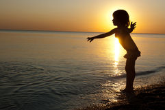 Kid on sunset beach Royalty Free Stock Photos