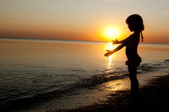 Kid on sunset beach Royalty Free Stock Images