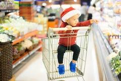 Kid supermarket royalty free stock photo