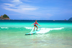 Kid surfing royalty free stock photo