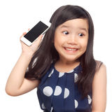 Kid surprised with smartphone. On white background Stock Image