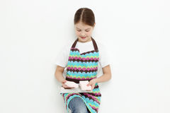 Kid and sweets Stock Images