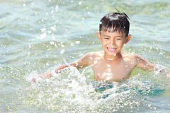 Kid swim in the beach Royalty Free Stock Image