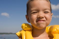 Kid with swiming vest weared Royalty Free Stock Photos