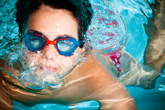 Kid swimming Stock Images