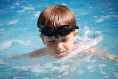 Kid swimming Royalty Free Stock Photography