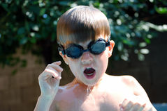 Kid swimming Stock Image