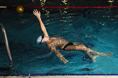 Kid swimming backstroke stock photo