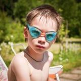 Kid in swimming googles Stock Photos