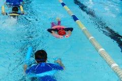 Kid swimming Stock Photo