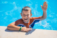 Kid swimming and playing in pool. summertime Royalty Free Stock Photo