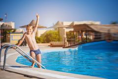 Kid swimming and playing in pool. summertime Royalty Free Stock Images